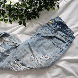 Ripped Light-Wash Girlfriend Jeans